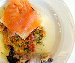 Carpaccio di salmone marinato agli agrumi con radicchio stufato e arrotolato da pancetta coppata e scamorza affumicata